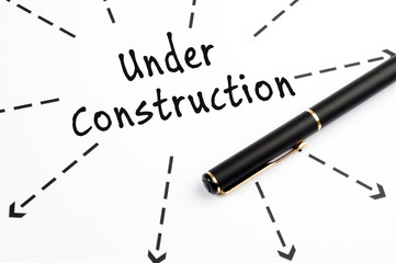 Under Construction word wih arrows and pen