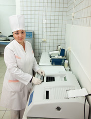 Doctor working with Biochemistry Analyzer