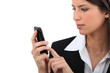 Businesswoman text on mobile