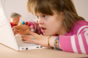A girl using a laptop.