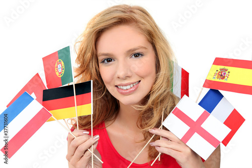 girl holding a bunch of national flags