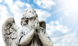 beautiful statue of the angel with cloudy sky