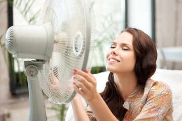 happy woman with big fan
