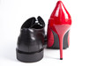 Leinwandbild Motiv Roter Pumps und schwarzer Herrenschuh