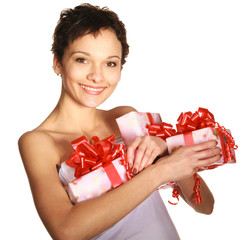 Beautiful brunette girl holding a gift boxes