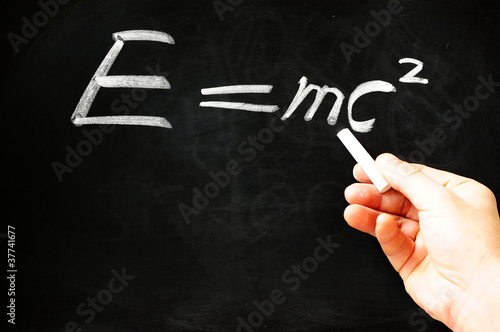 poster of E=mc² Albert Einsteins physical formula on blackboard