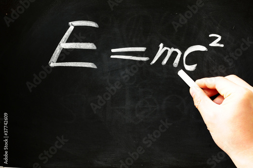 poster of E=mc² Albert Einsteins physical formula on blackboard