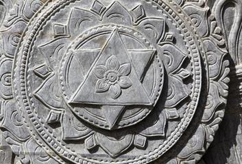 Stone sculpture of mandala