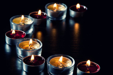 Semicircle of burning tea light candles