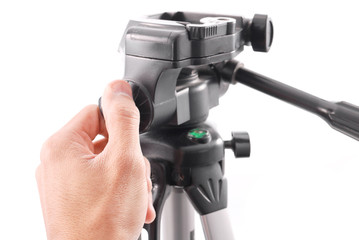 Hand Securing a Swivel Lock on Tripod