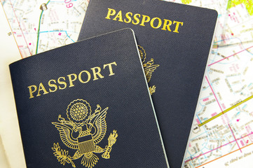 Closeup of US passports on a map
