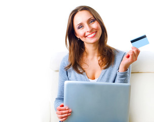 Smiling Woman shopping online with credit card. E-shopping