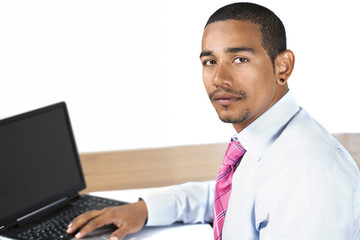 Hispanic office man looking up serious expression