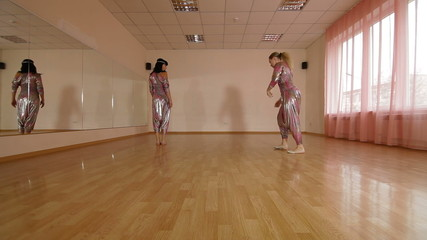Dancers in Dance Studio Practicing