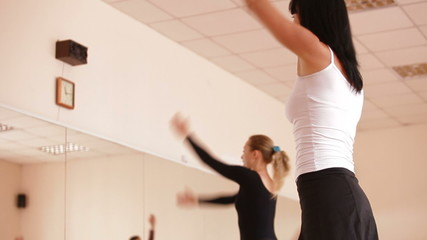 Women with coach stretching in Dance Studio