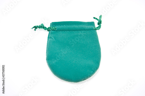 Green pouch to hold Jewelry and delicate items isolated on white