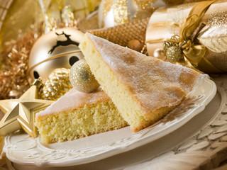 Slice cake over golden table