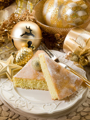 Slice cake over golden table