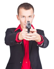 gunman ready to shoot, white background. focus on gun