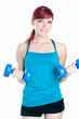 Young woman exercising with dumbbells, white background