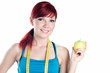 Smiling young woman with an apple and a centimeter