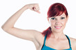 Sportive woman smiling and demonstrating her biceps