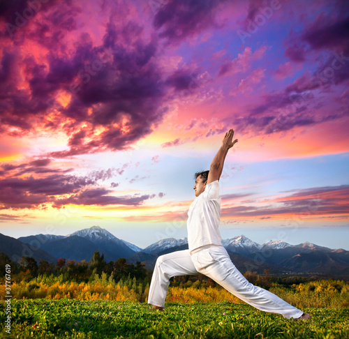 Yoga warrior pose in mountains