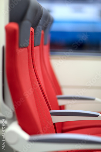 Red chairs in train