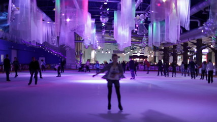 Skating rink in the winter in violet light. Timelapse