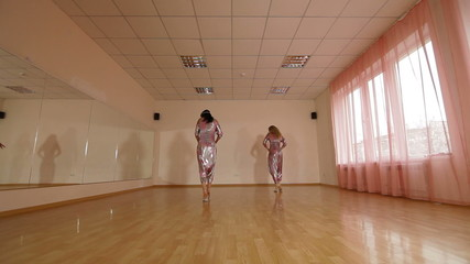 women practicing contemporary dance in the dance studio