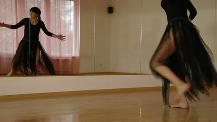 woman dancing modern dance in Dance Studio
