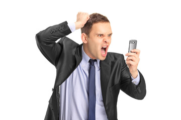 Businessperson screaming on a mobile phone