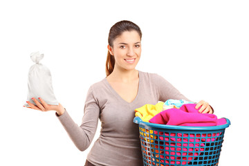 A woman with a laundry basket holding a money bag