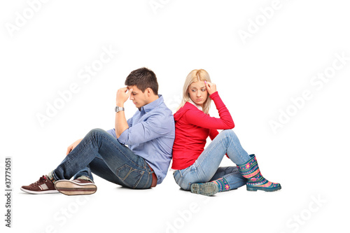 Couple sitting with their backs turned after having an argument