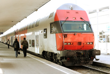 Modern doubledeck train on a platform