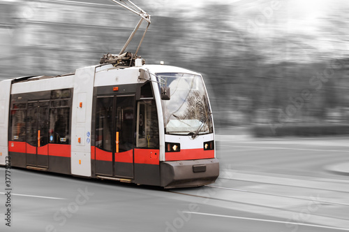Modern city tram on moving - 37775273