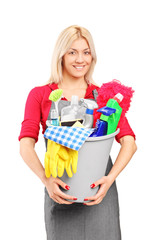 Female cleaner holding a bucket with cleaning supplies