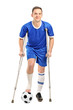 Injured soccer football player on crutches