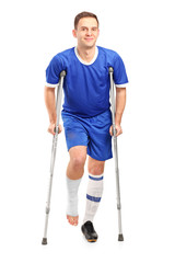 Full length portrait of an injured soccer football player on cru