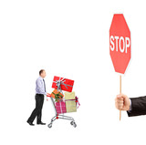 Man pushing a shopping cart full with gifts and a hand holding a