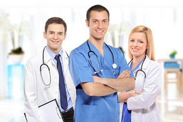 Medical team consisting of three smiling doctors