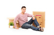 Smiling man resting from moving into a new home