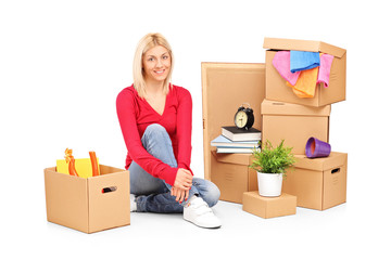 Smiling woman resting from moving into a new home