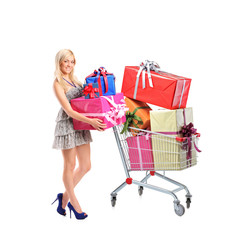 Full length portrait of a female holding  gifts and a shopping c