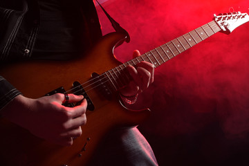rock guitarist playing at a live concert