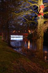 Night park view for climbing Santa Claus