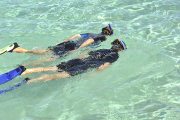 Father and daughter snorkeling