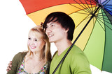 mixed race couple under umbrella