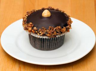 Chocolate cupcake with crushed walnuts and macadamia nut
