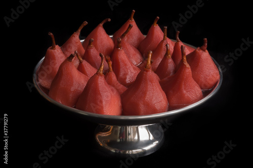 Poached pears in a metal bowl